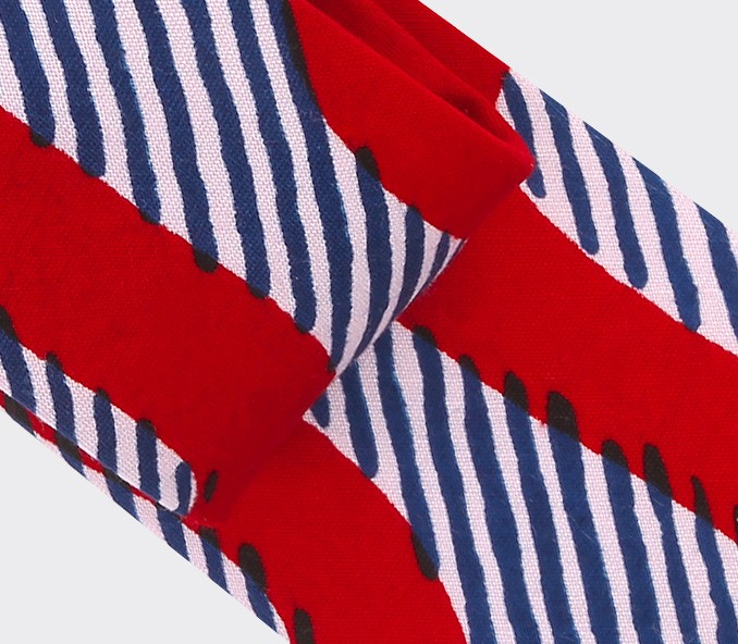 Tie Cinabre made of wax red waves. Available in Paris