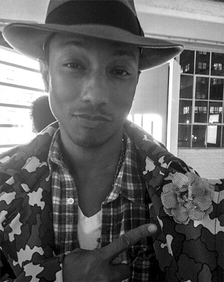 Pharrell Williams wearing a Cinabre flower lapel pin